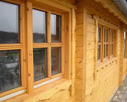 kantholz oder rundholz als blockbalken oder naturstamm blockhaus. Black Bedroom Furniture Sets. Home Design Ideas